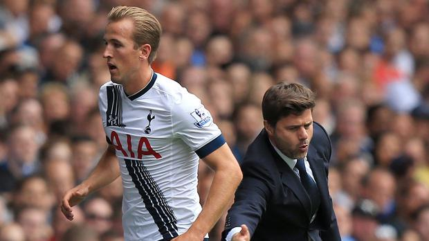 Harry Kane, left, was taken off with Tottenham leading