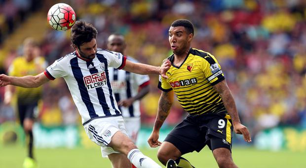 Troy Deeney, right, cut a frustrated figure against West Brom