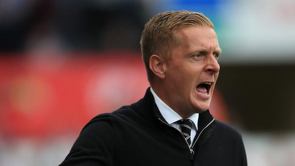 Swansea manager Garry Monk, pictured, has completed the signing of Falkirk prospect Botti Biabi