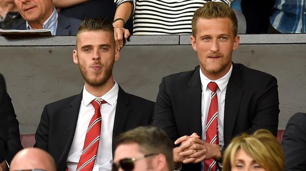 David De Gea, left, will be in the stands at Old Trafford again on Saturday
