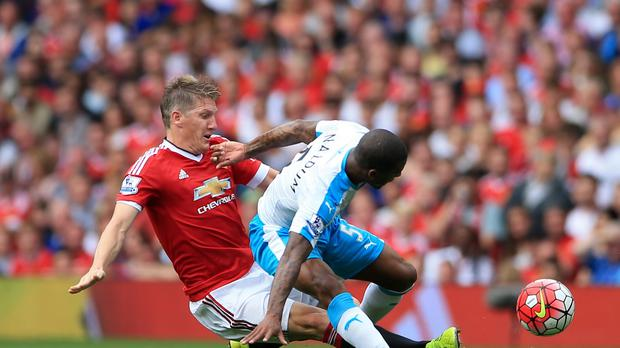 Manchester United's Bastian Schweinsteiger and Newcastle United's Georginio Wijnaldum battle for the ball