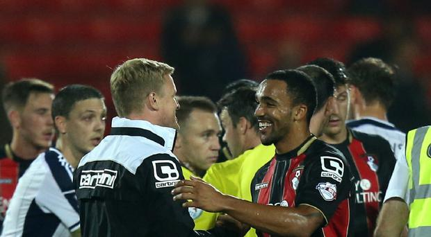 Bournemouth manager Eddie Howe (left) praised Callum Wilson after his hat-trick sank West Ham on Saturday.