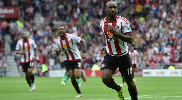 Sunderland's Jermain Defoe celebrates scoring his teams opening goal during the Barclays Premier League match at The Stadium of Light, Sunderland.