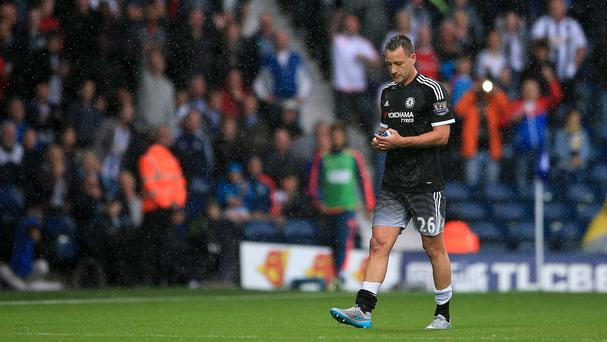 John Terry walks off after being dismissed in Chelsea's 3-2 win at West Brom