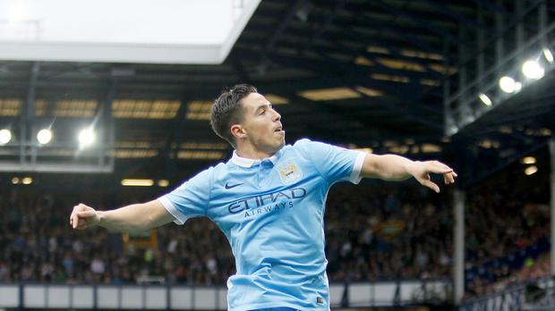 Samir Nasri scored as Manchester City maintained their winning start to the season with victory at Everton