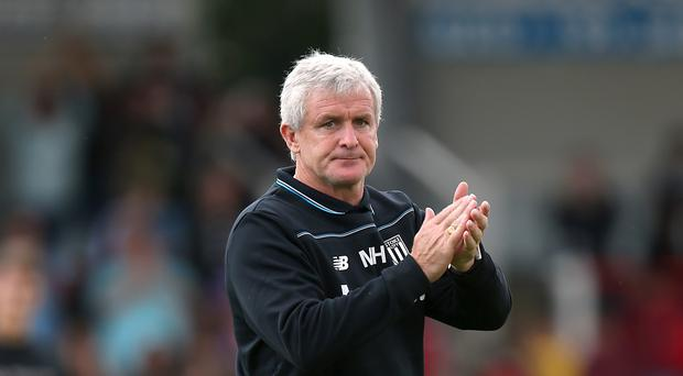 Mark Hughes, pictured, is keen for Jon Walters to stay at Stoke
