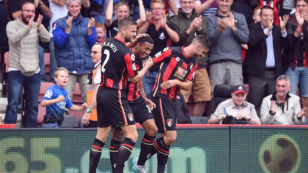AFC Bournemouth's Callum Wilson (centre) celebrates with his teammates after scoring his side's first goal of the game during the Barclays Premier League match at the Vitality Stadium, Bournemouth.