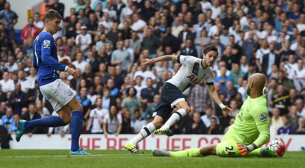 Tim Howard, pictured right, frustrated Spurs at White Hart Lane