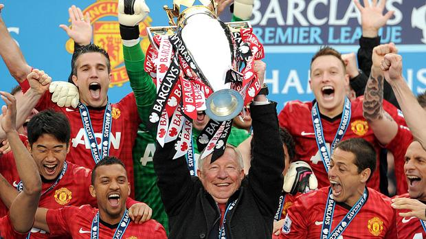 Sir Alex Ferguson (centre) lifting the Premier League in 2013