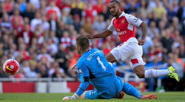 Theo Walcott opened the scoring for Arsenal