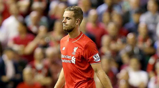Liverpool captain Jordan Henderson is in the United States having his heel injury assessed by a specialist.