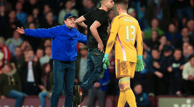 Aston Villa fans intimidate West Bromwich Albion goalkeeper Boaz Myhill during a pitch invasion after the FA Cup game in March.