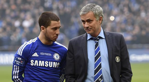 Jose Mourinho, right, has backed Eden Hazard, left, to rekindle last season's form