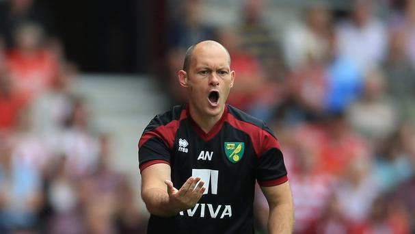Norwich manager Alex Neil has told his players to show no fear against Liverpool on Sunday