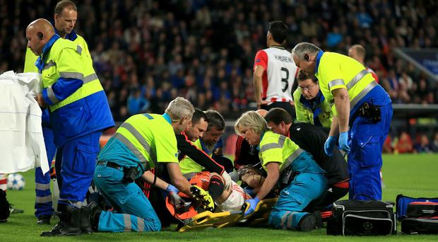 Luke Shaw, centre, broke his leg against PSV Eindhoven