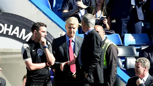 Chelsea manager Jose Mourinho (right) and Arsenal manager Arsene Wenger (centre) went head to head at Stamford Bridge.