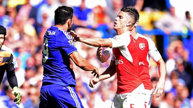 Diego Costa, left, and Gabriel confront each other at Stamford Bridge