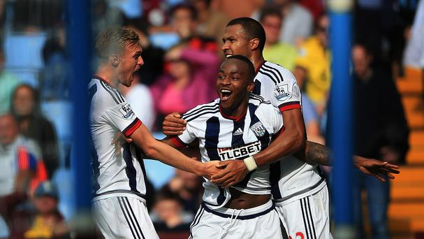 West Brom's Saido Berahino (centre) celebrates his winner at Aston Villa with Darren Fletcher (left) and Solomon Rondon.