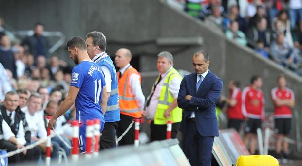 Everton manager Roberto Martinez looks down as Kevin Mirallas is sent off in the final seconds of their goalless draw at Swansea.