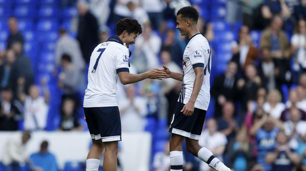 Heung-Min Son, left, has been endearing himself well with Tottenham's players and fans