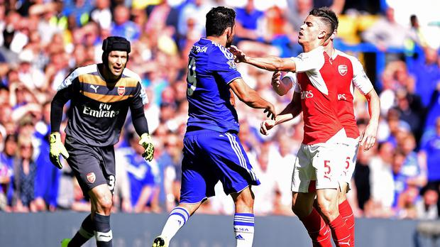 Arsenal's Gabriel Paulista, right, was sent off after clashing with Chelsea's Diego Costa on Saturday
