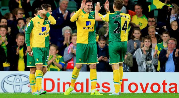 Back in business: Kyle Lafferty is on target as Norwich City see off West Brom in the Capital One Cup