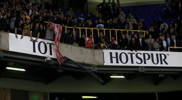 Some Arsenal fans tore down advertising signs in the stand at White Hart Lane