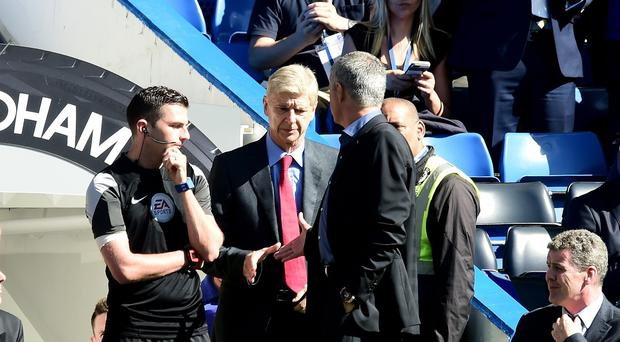 Chelsea manager Jose Mourinho (right) and Arsenal manager Arsene Wenger (centre) appear to still be feuding