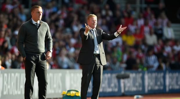 Southampton manager Ronald Koeman, right, saw plenty to improve on despite victory over Garry Monk's Swansea