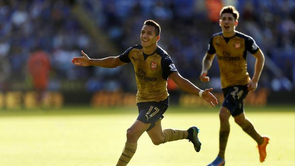 Arsenal's Alexis Sanchez celebrates his hat-trick during the Gunners' 5-2 win at Leicester.