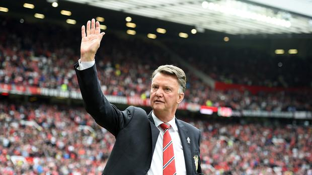 Louis van Gaal waves to the fans after United's win
