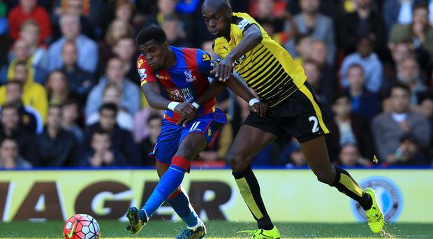 Wilfried Zaha (left) came off the bench to win the decisive penalty as Palace beat Watford