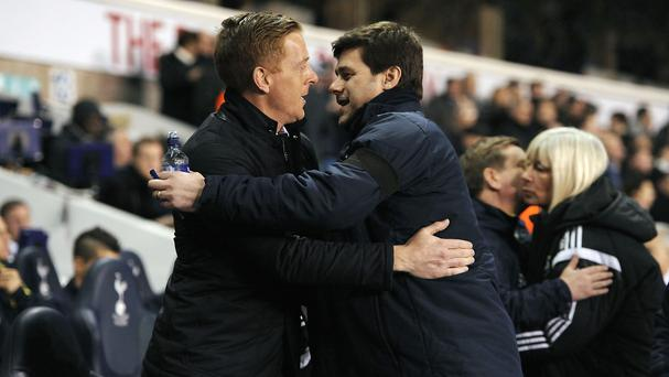 Swansea manager Garry Monk, left, admires the work done by Tottenham boss Mauricio Pochettino