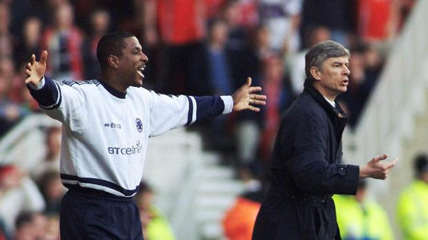 Former Arsenal defender Viv Anderson, left, has backed Arsene Wenger, right, to lead the club's title challenge