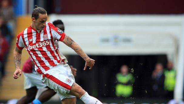 Stoke's Marko Arnautovic scores the winner at Aston Villa after being set up by Glen Johnson.