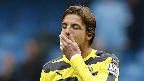 Newcastle goalkeeper Tim Krul suffered a knee injury while playing for Holland