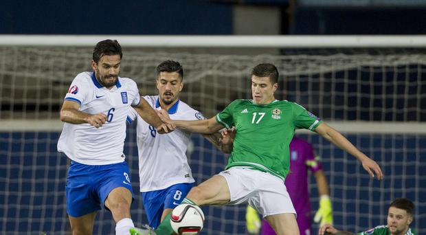 Paddy McNair, pictured right, suffered an abdominal injury in Northern Ireland's game against Finland