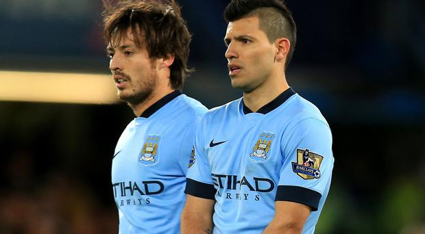 Manchester City duo Sergio Aguero, right, and David Silva, left, both picked up injuries on international duty