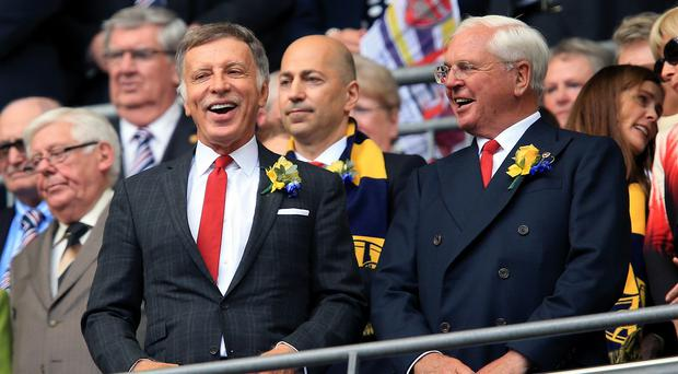 Arsenal chairman Sir Chips Keswick, right, has defended a payment to shareholder Stan Kroenke, left