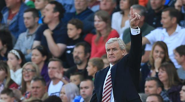 Mark Hughes (pictured) takes his Stoke side to Wales to face Garry Monk's Swansea on Monday.