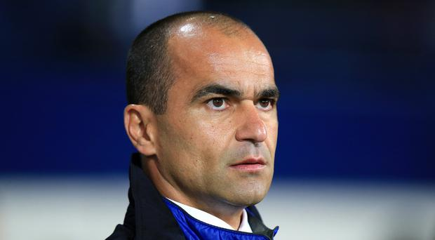 Everton manager Roberto Martinez, pictured, is wary of Wayne Rooney's threat ahead of the visit of Manchester United