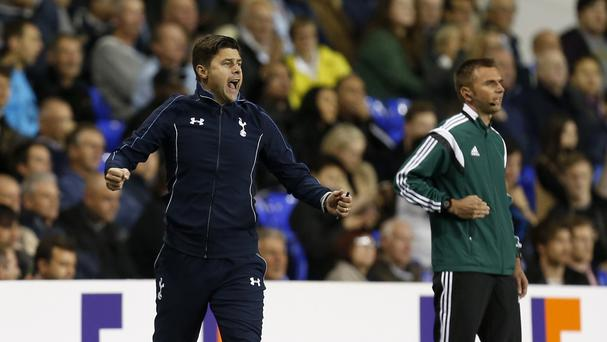 Mauricio Pochettino, pictured, says just as much pressure comes with his job as Jurgen Klopp's