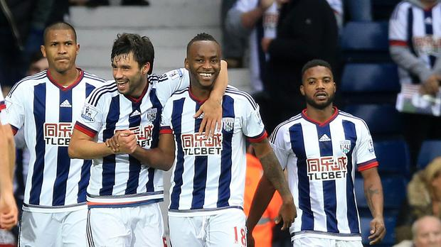 Saido Berahino, centre right, celebrates scoring his side's winner over Sunderland