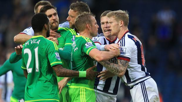West Brom's James McLean (right) confronts Sunderland's Lee Cattermole (3rd right) after Albion's 1-0 win on Saturday.