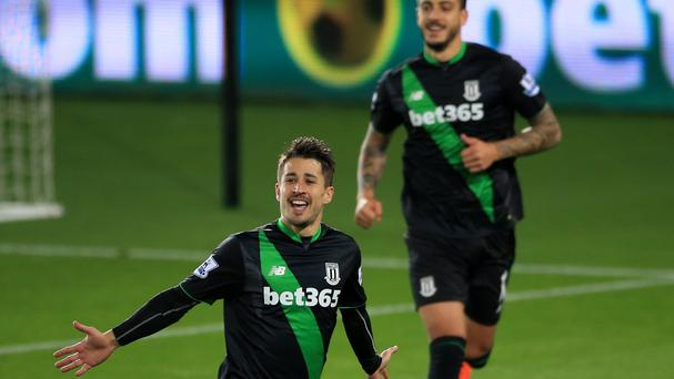 Stoke's Bojan Krkic (left) celebrates scoring his side's winner from the penalty spot in their 1-0 victory at Swansea.