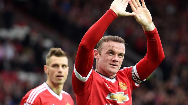 Wayne Rooney (right) celebrating his first league goal of the season