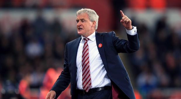Stoke manager Mark Hughes was angry over replays being shown on the big screen of an incident involving his goalkeeper Jack Butland at Swansea.