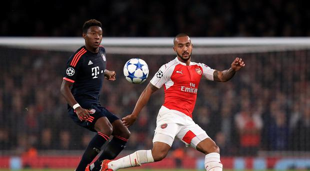 Theo Walcott (right) believes the Champions League victory over Bayern Munich showed Arsenal mean business this season.