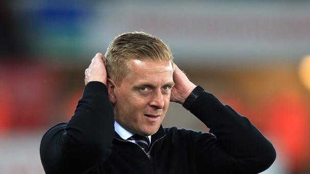Swansea manager Garry Monk has called reports that his job is under review as 'farcical'