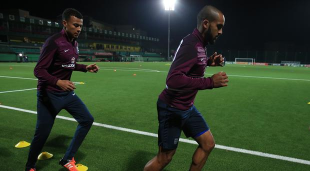 England's Theo Walcott (right) was left on the bench at the LFF Stadium in Vilnius.